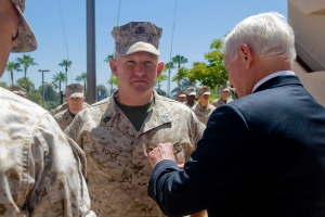 Secretary of Defense Robert M. Gates presents the Purple Heart to Marine Gunnery Sgt. David Rohde at Balboa Naval Hospital in San Diego